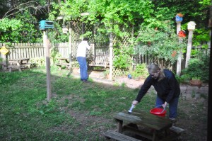 As Lena vacuums out on the porch, Daniel rakes and Erica scrubs the picnic table.  Looks like a picnic shaping up.  Thank you, thank you, thank you!
