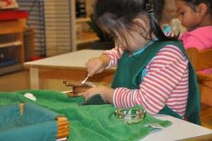 . . .polishing a little elephant made of wood. . .