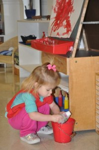 . . .painting on the easel with some nice red paint and cleaning it all up!