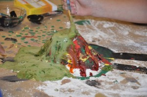 """""""Step Back Volcano"""" was about an experience in a STEAM class. You can find it at:https://www.northwoodsmontessori.org/step-back-volcano-story-without-words/"""