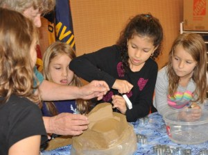 We started with a big block of clay, which we were astonished to see cut be cut into pieces using dental floss!