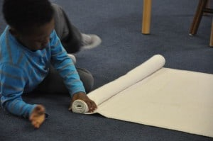 Rolling mats and putting them away carefully requires precise movements.