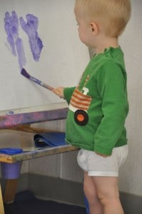 E) expressing ourselves in painting,
