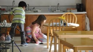 Eating snack together, but especially enjoyable is the clean-up, in which we sweep up every crumb.