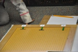 . . .then, after we put a black line under the three green beads and proceeded to start the line of multiples of four.