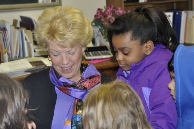 In another photo that has appeared in our blog, a group of children bring birthday greetings to Beth, one of our founders and our Executive Director, in her office.