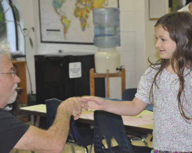 A handshake with the teacher sets the tone for a friendly and respectful relationship.