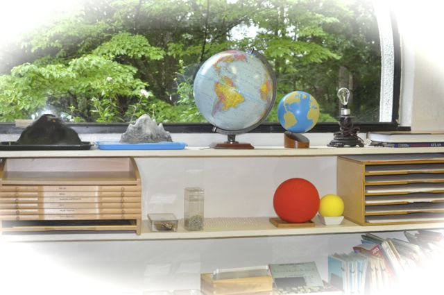 Some of the Elementary Geography materials call beguilingly from a shelf by a window.
