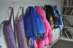 We solved the problem of storage for our class yoga mats by sewing individual yoga bags which we can hang on our coat hooks.