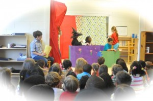 We were a part of the audience as some older children put on an original play, complete with a narrator, a stage manager and props.
