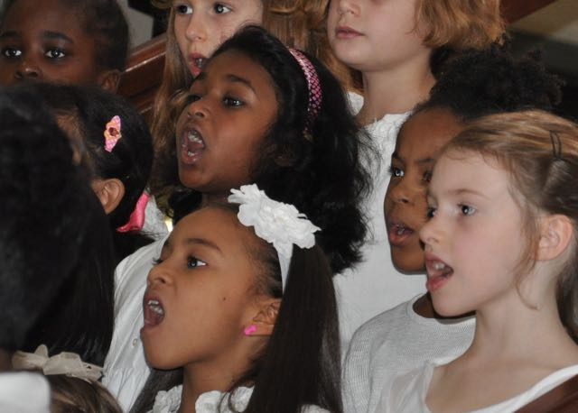 """Our chorus belted out new and traditional songs and even led the audience in """"Jingle Bells."""""""