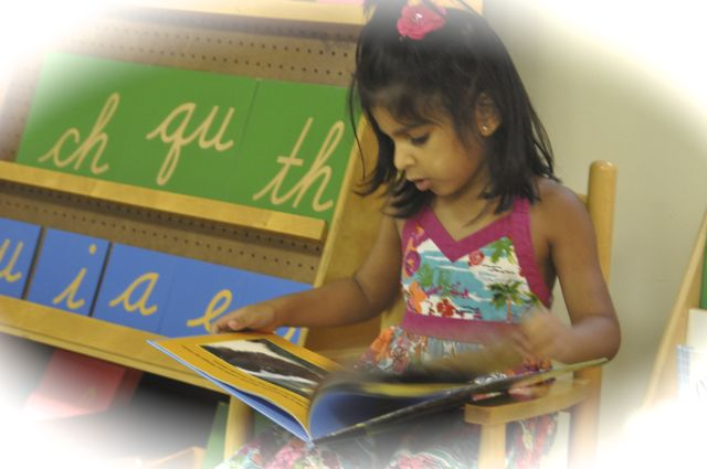 """From the beginning, while we were still pouring water, playing with sounds in the """"I Spy"""" game and looking at books, we noticed the Sandpaper Letters.  They are sometimes displayed on a shelf or rack and sometimes found in a big box on the shelf."""