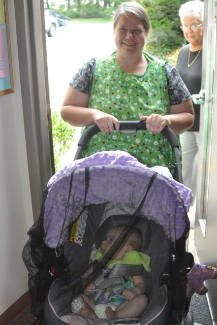 Pamela Baumbarger returns to Northwoods to revive our Infant/Toddler program, the AMI Assistants to Infancy. Here she returns from a walk outside with a child in a stroller.