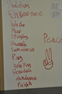 """Say the word!  An Elementary child has researched the way to say, """"Peace"""" in several languages and has created a sign to help teach his class for part of their number for the Peace Celebration."""