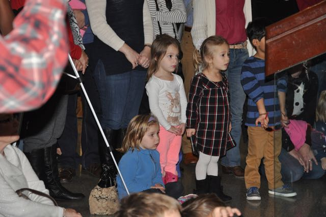 Brothers and sisters of chorus members watched from the front of the audience with parents and grandparents.