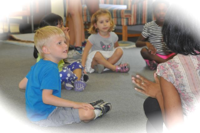 A small group gather for movement and music at a SummerScapes afternoon Musicgarten session.