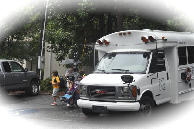 Children arrive on the Northwoods bus as they have year after year.